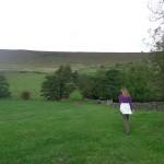 Em making her way across the fields