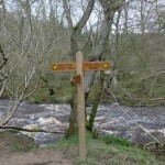 Sign post to the waterfall or turn right to miss it out